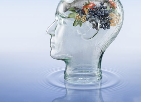 Glass head with health foods recommended for mental agility.